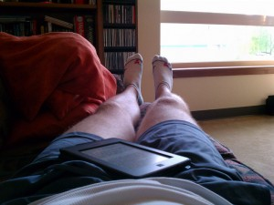 Relaxing and reading after my 10 km run.