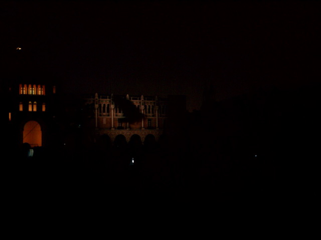 Centennial Spectacle: Flying owl projected onto Herzstein Hall, Lovett Hall, and Sewall Hall.