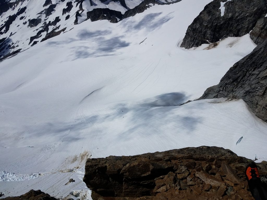 "View from the ""Sidewalk"" of Dome Peak, with climbers on the Dome Glacier."